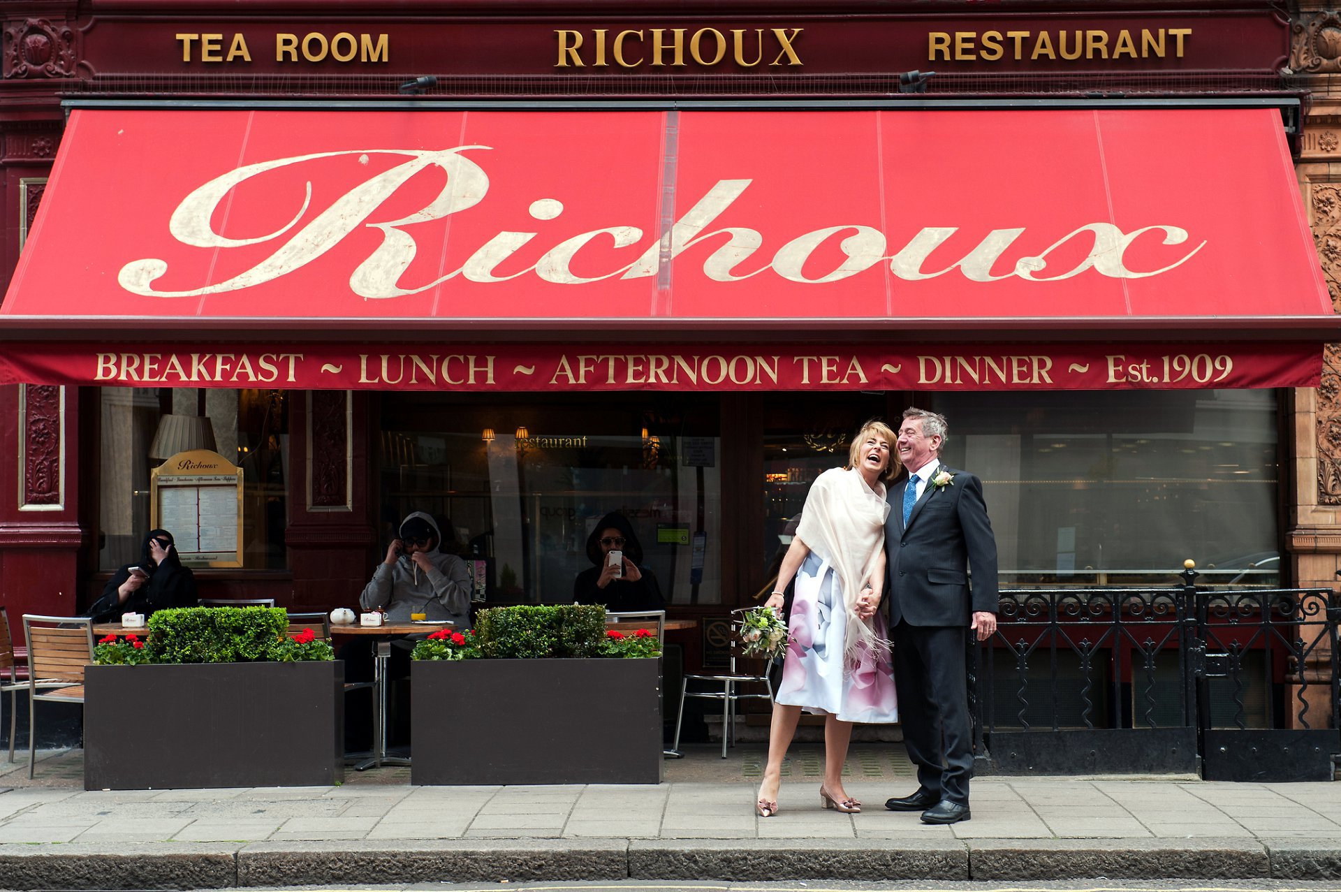 Richoux Wedding Reception - bride & groom outside their wedding reception venue, Richoux in London's Mayfair