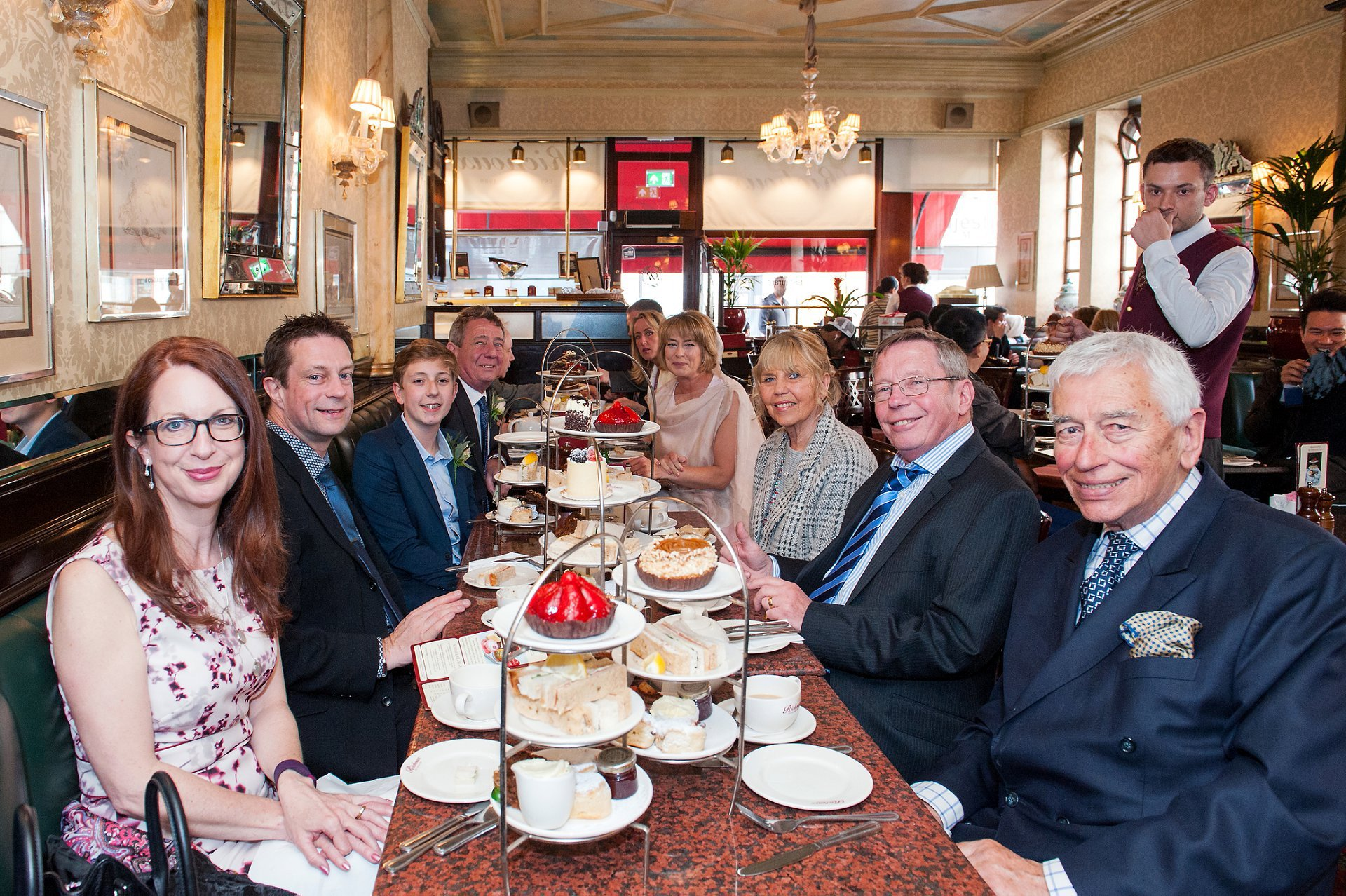 Guests celebrate wedding reception in Richoux, South Audley Street, Mayfair, London with a delicious tea wedding breakfast