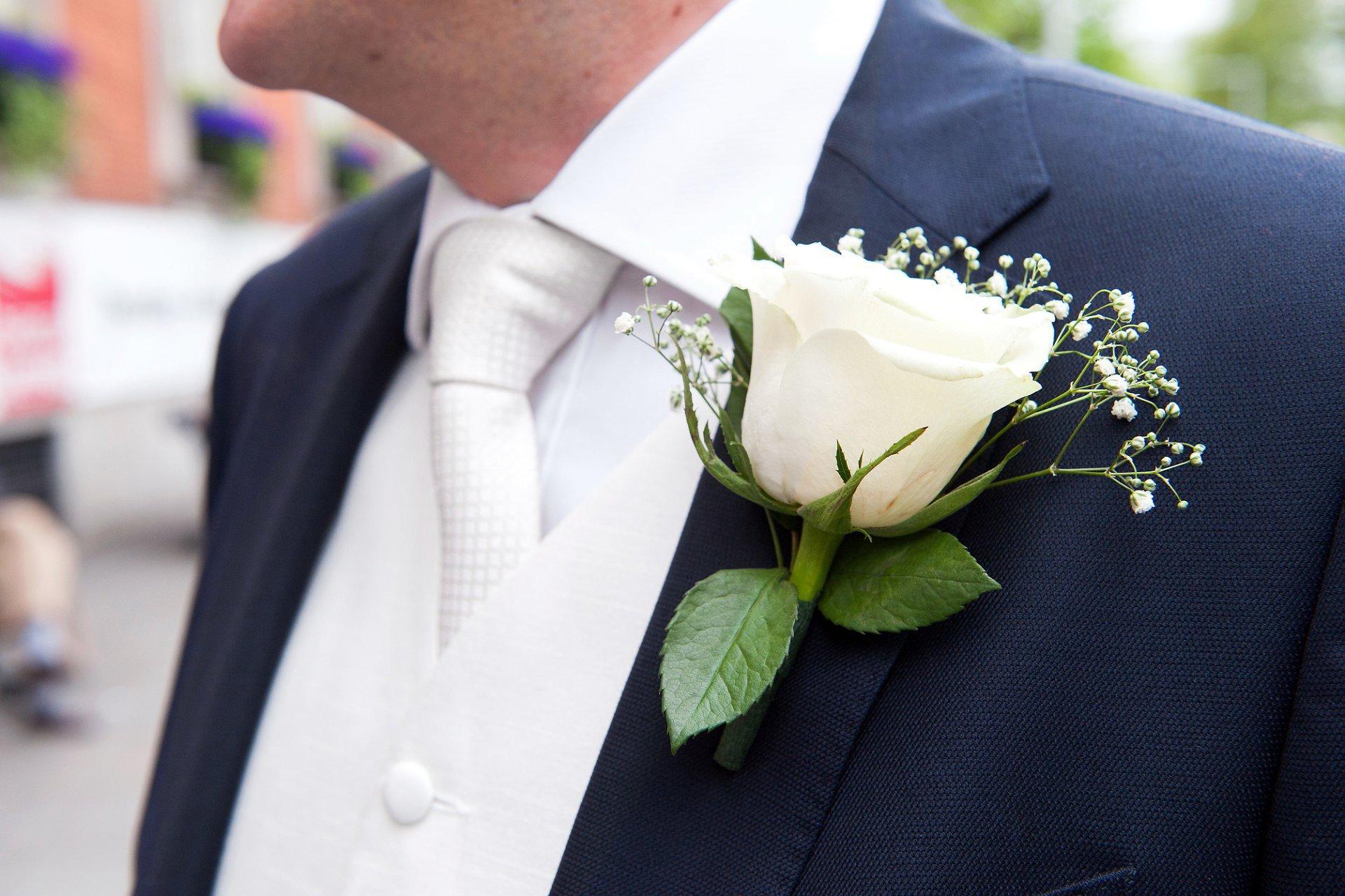 George's cream rose buttonhole