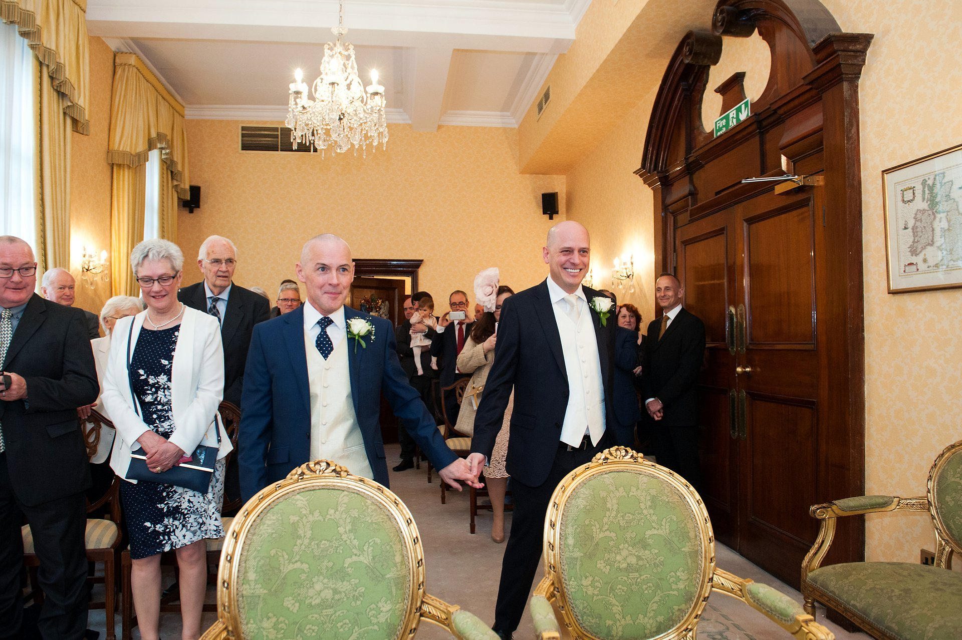 George & Jose walk into the Brydon Room together for their Chelsea Reigstry Office wedding