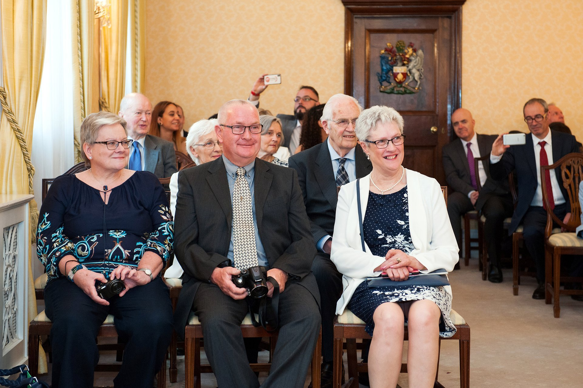 Wedding guests in the Brydon Room at Chelsea Registry Office