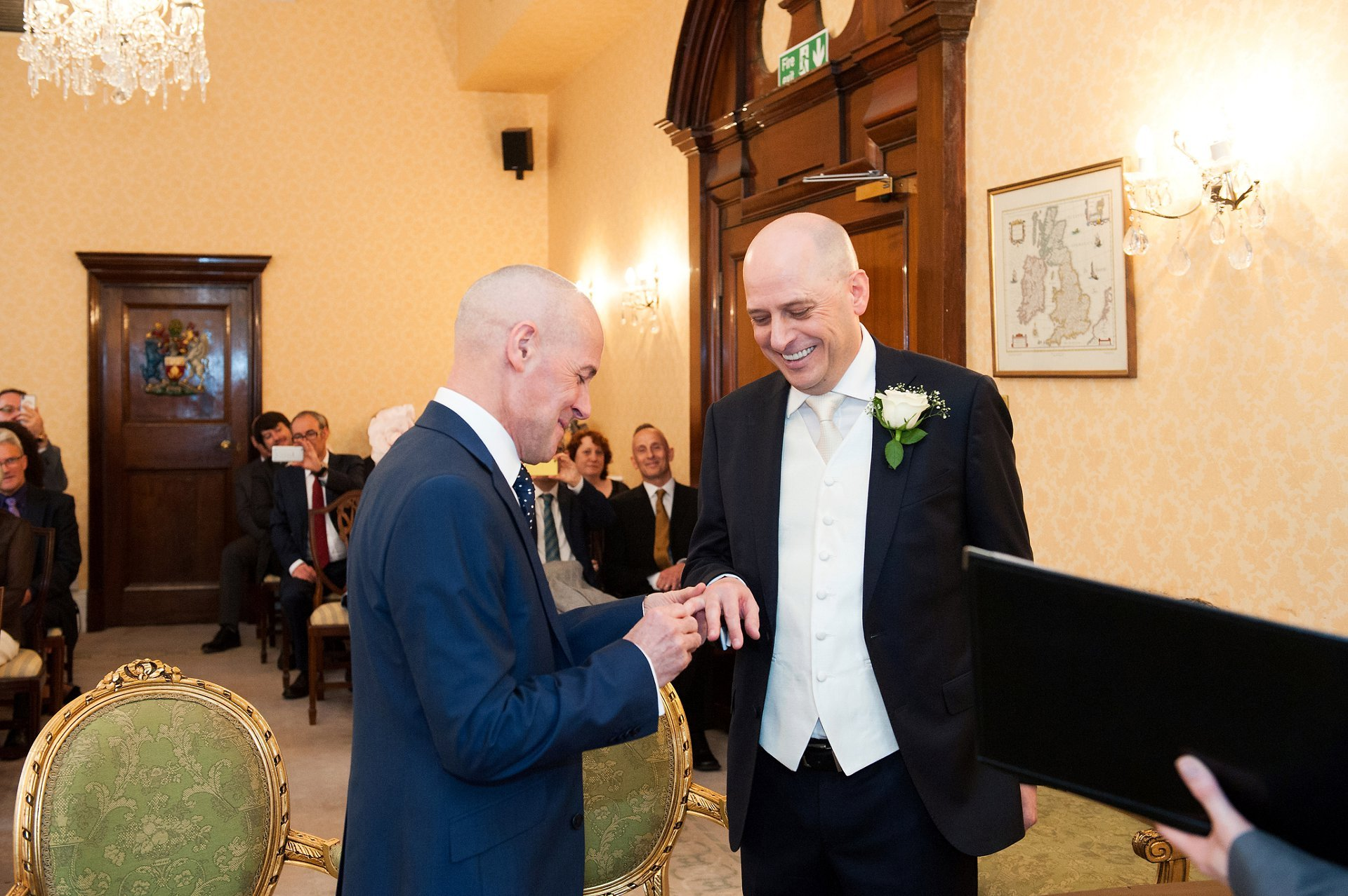 George places the ring of Jose's finger during the ring exchange in Chelsea Old Town Hall
