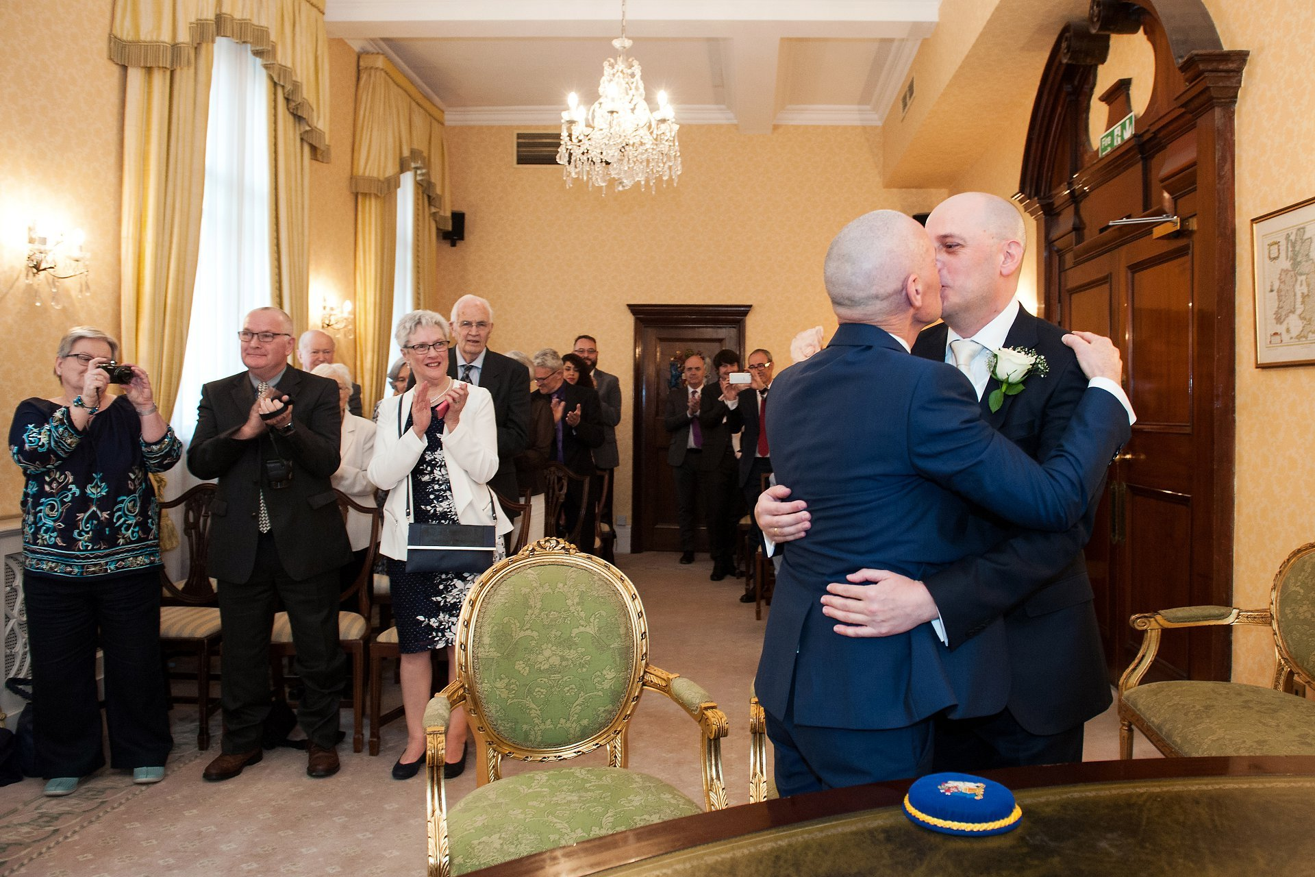 George and Jose kiss to celebrate their marriage in Chelsea Register Office