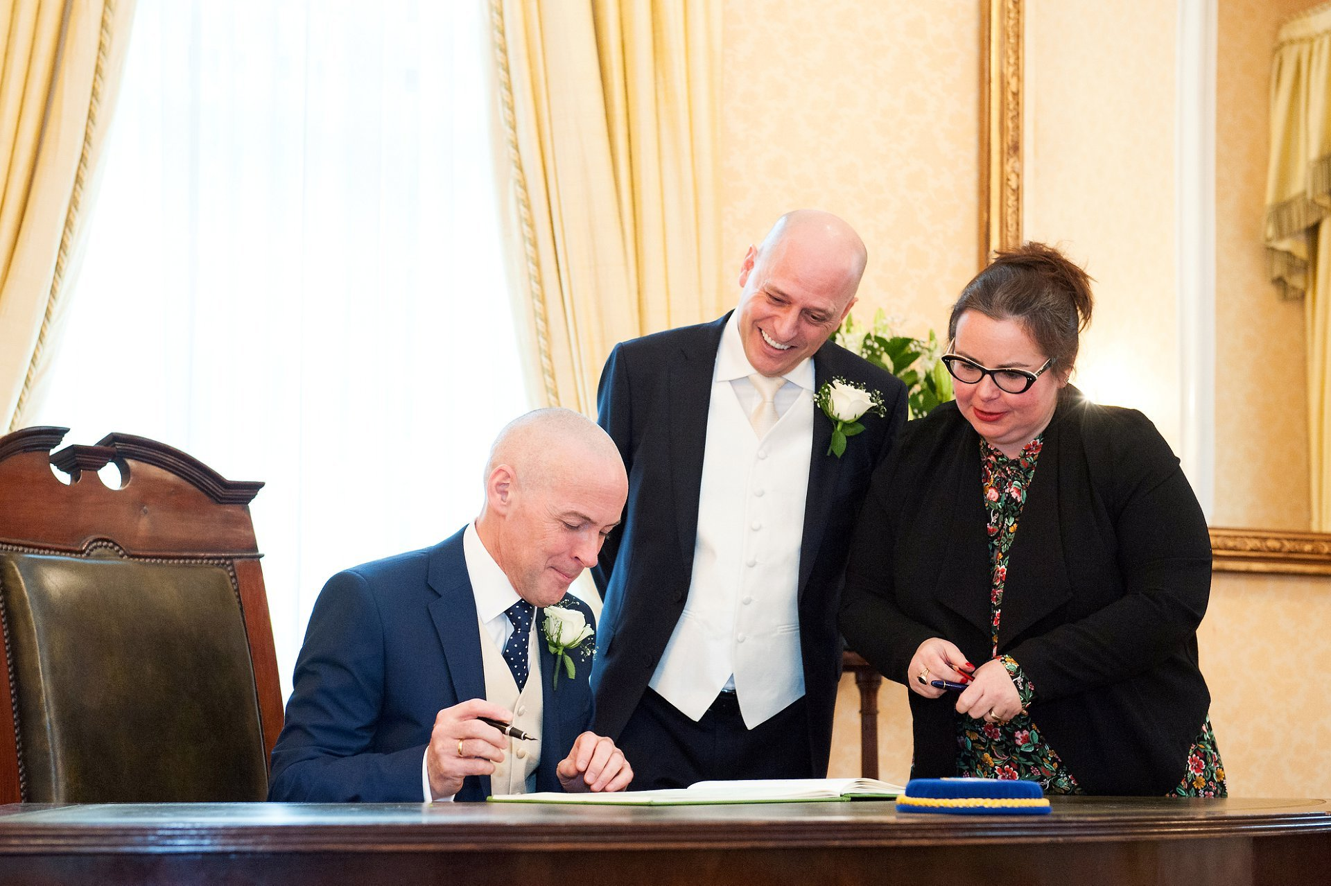 Signing the marriage register in the Brydon Room at Chelsea Old Town Hall