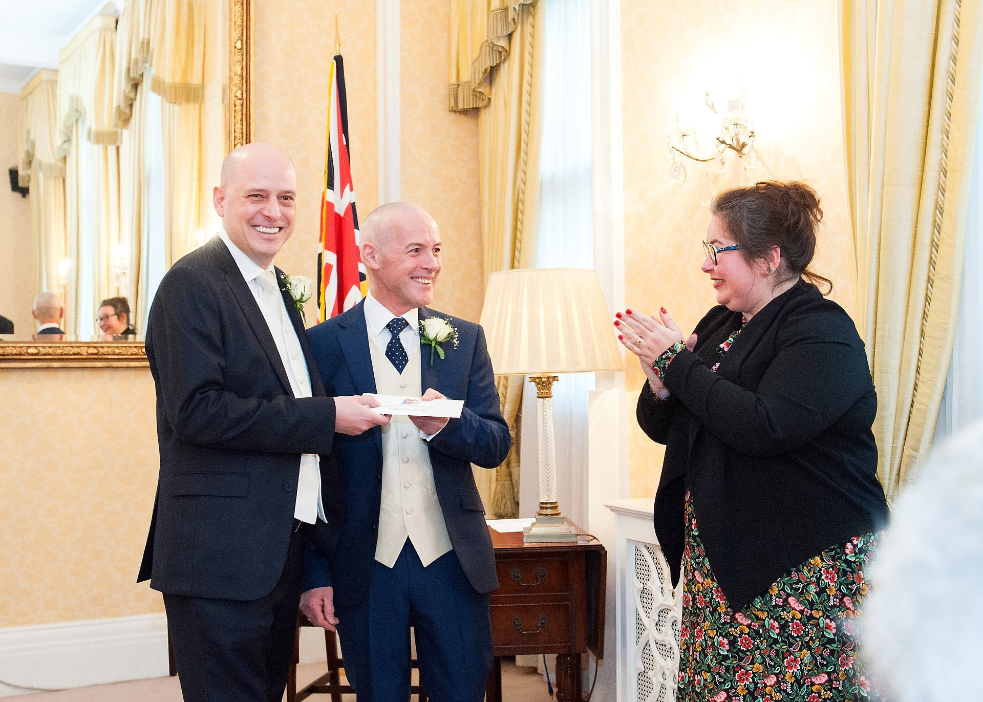 The Kensington and Chelsea Registrar congratulated teh happy couple and hands over their marriage license