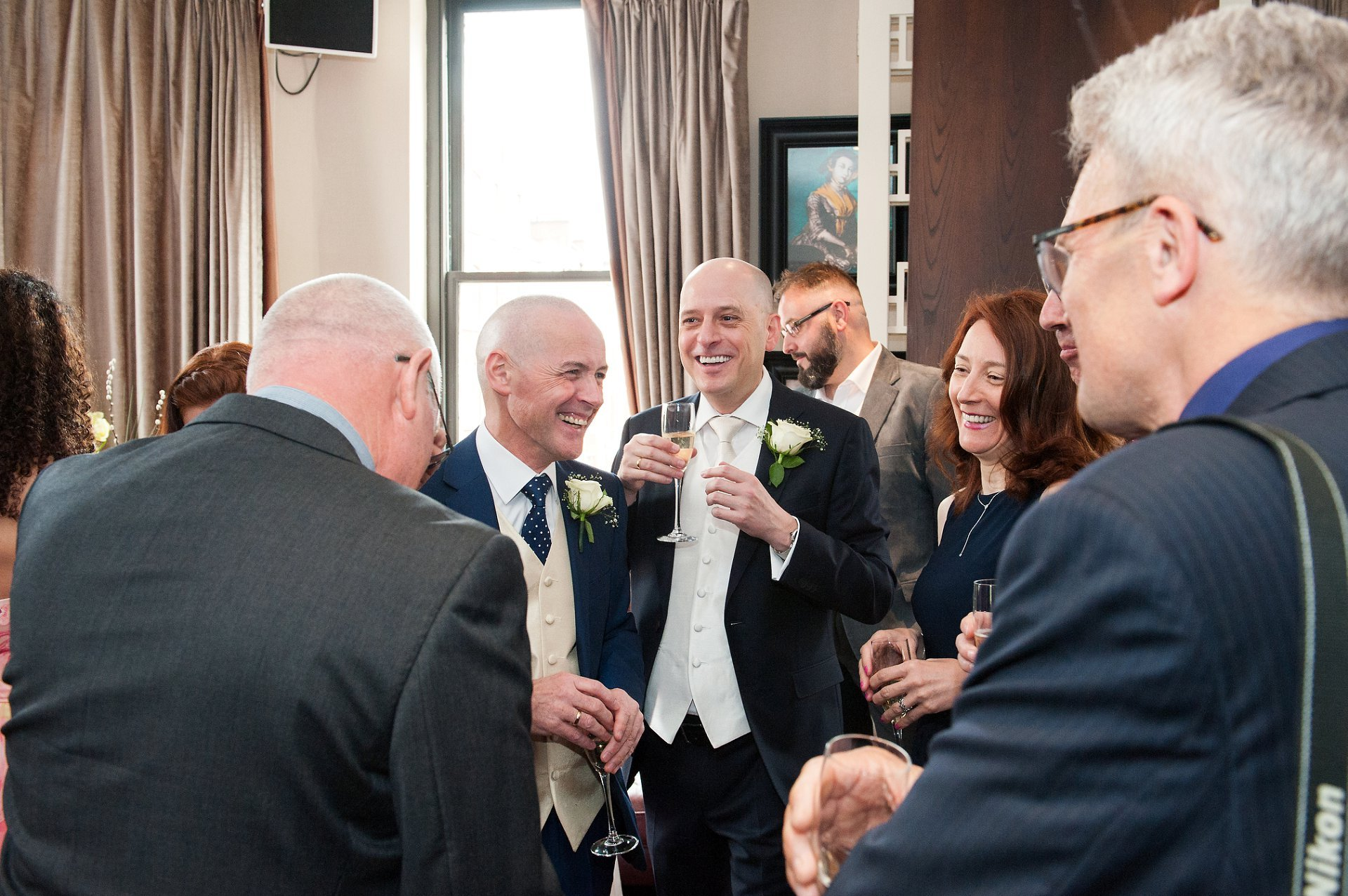 George and Jose chat to friends and family during their wedding reception at Beaufort House