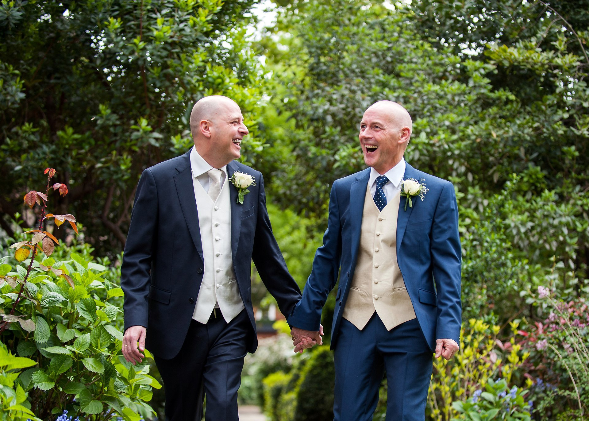 Jose and George laughing together as they celebrate their Chelsea wedding