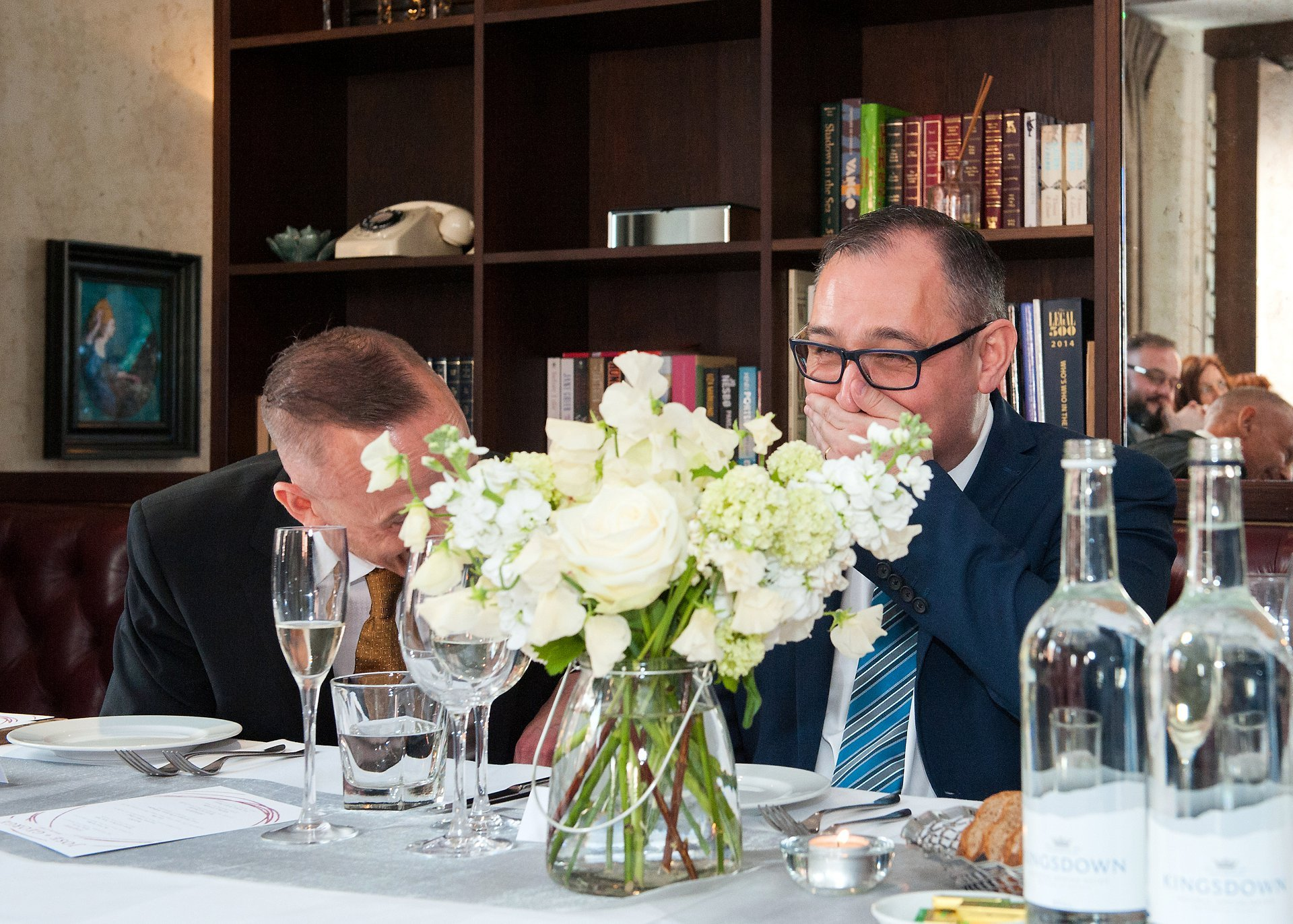 Guilio laughing during George's wedding speech at Beaufort House