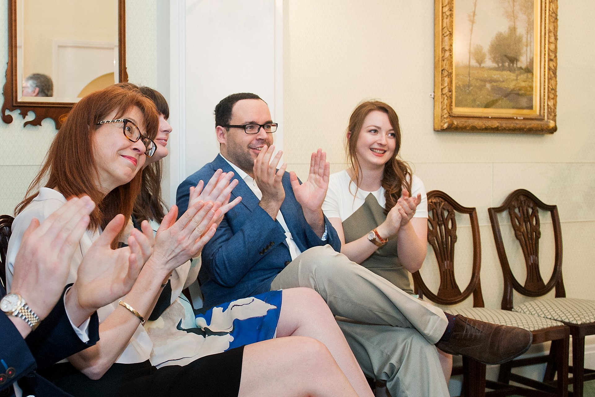 Guests in Chelsea's Rossetti Room clap the bride and groom on their marriage