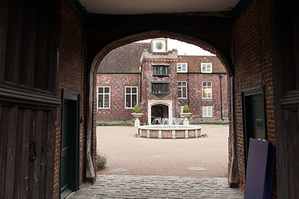 The historic Grade I listed Tudor courtyard and fountain inside the gates at west London wedding venue, Fulham Palace