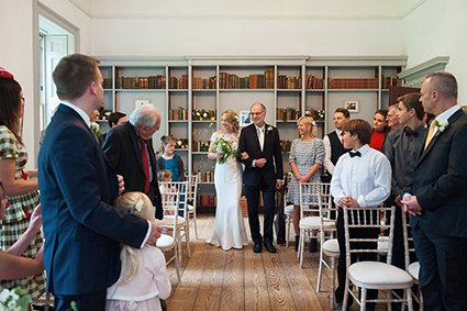Bride and her father walking into the Bishop Terrick's Drawing Room at Fulham Palce for a civil wedding ceremony