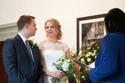 Bride and groom smiling during their Fulham Palace civil marriage ceremony handled by Hammersmith and Fulham Registry Office