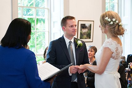 Wedding vows and the exchange of rings at this Autumn wedding at Fulham Palace in west London