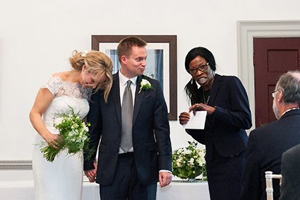 In the Bishop Terrick's Drawing Room at Fulham Palace the Hammersmith and Fulham Registery Office Registrar makes the bride and groom laugh at the end of their civil marriage ceremony just before she hands over the wedding certificate