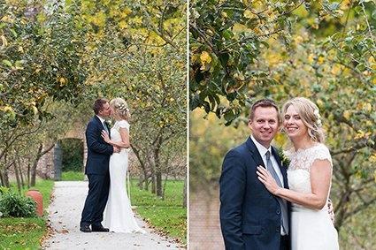 The stunning ancient orchard in the walled garden at Fulham Palace with a bride and groom posing for their wedding portrait photography