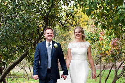 Bride and Groom portrait in the ancient botanical walled garden at Fulham Palace after their civil wedding ceremony