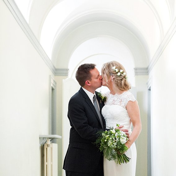 Fulham Palace wedding in the Bishop Terrick's Drawing Room - a bride and groom kiss after their Hammersmith and Fulham Register Office registrar civil marriage ceremony in this historic Grade I listed west London wedding venue