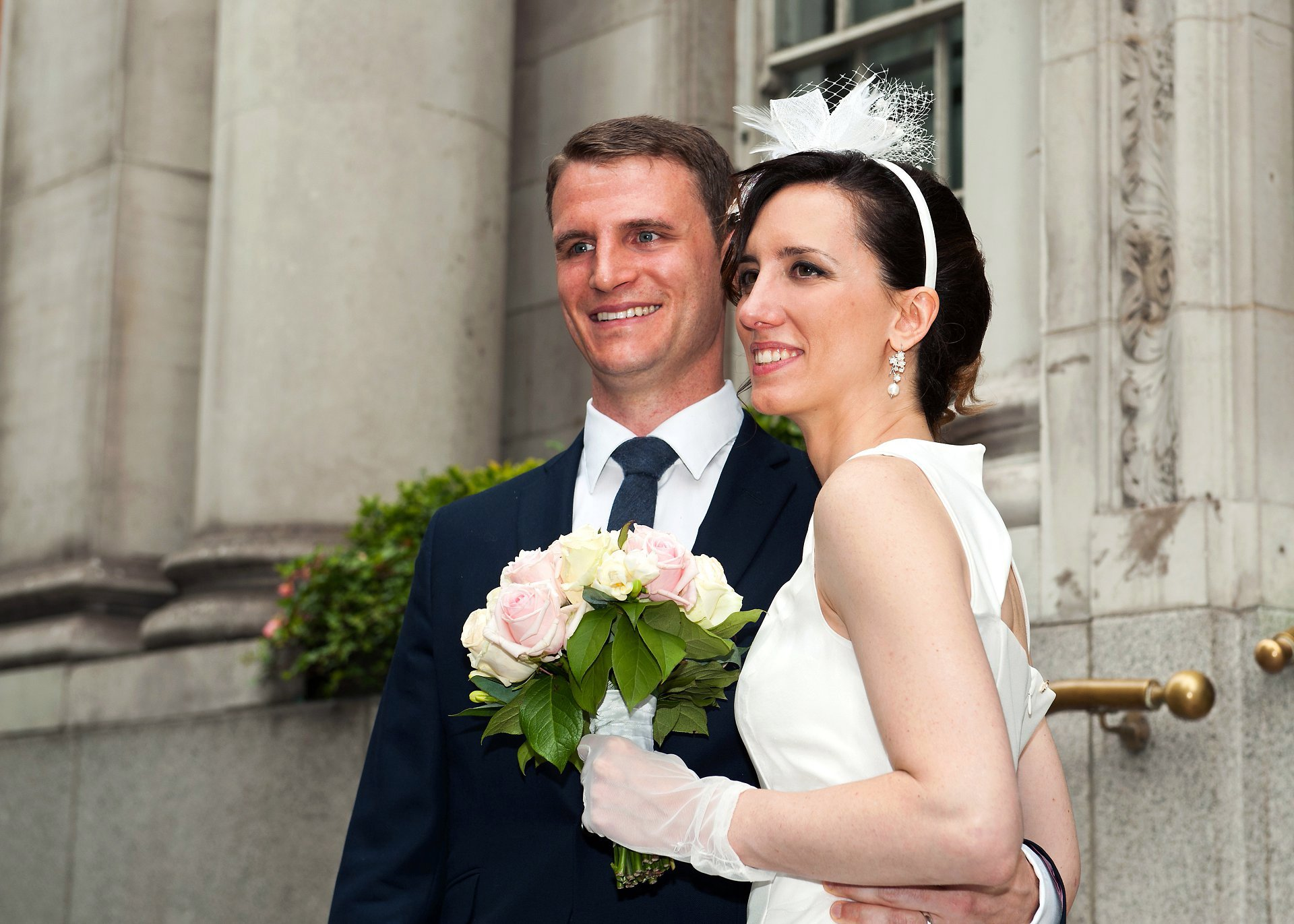 A bride and groom in the steps outside Chelsea Registry Office