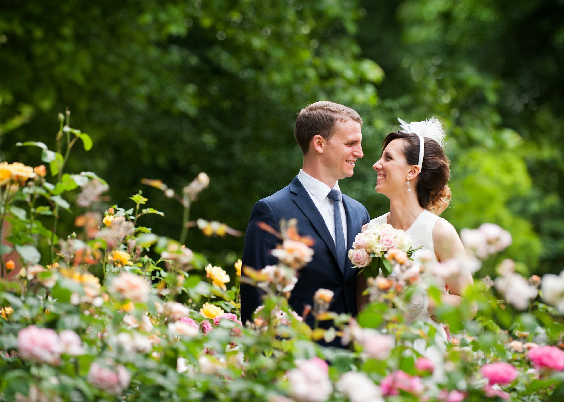 Bride and groom in a rose garden in Chelsea