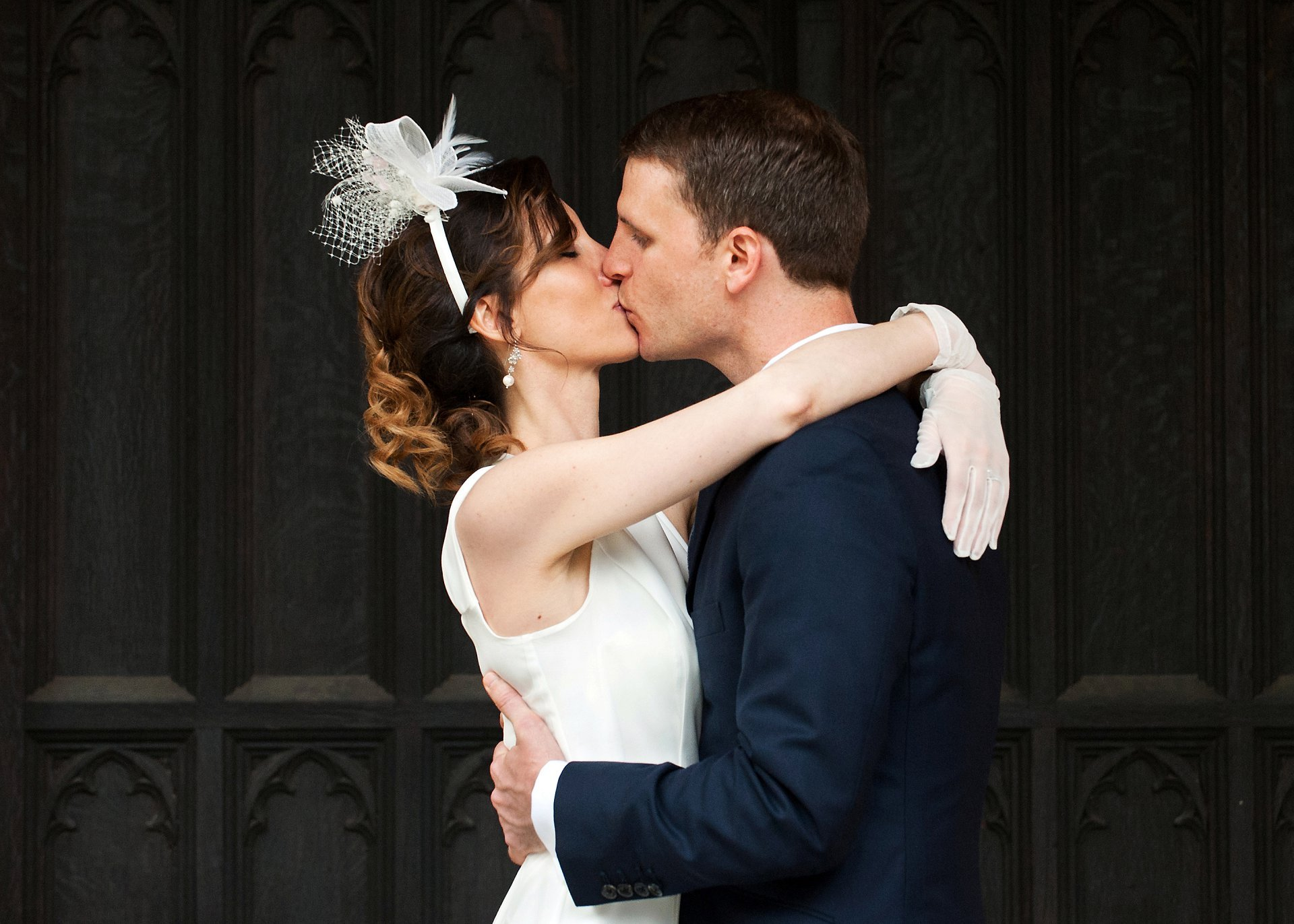 Bride and groom kiss after their Chelsea wedding