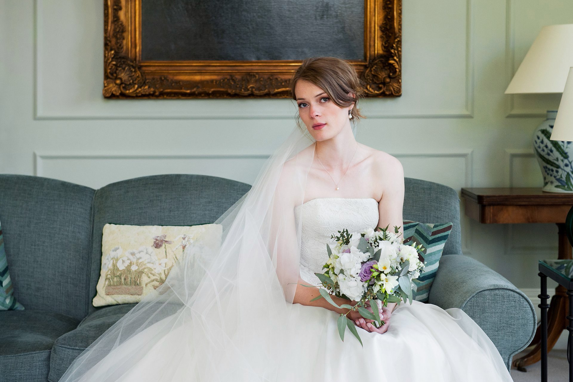 Starborough Manor Wedding Photographer - bride, Jess, in the drawing room at Starborough Manor on her wedding day