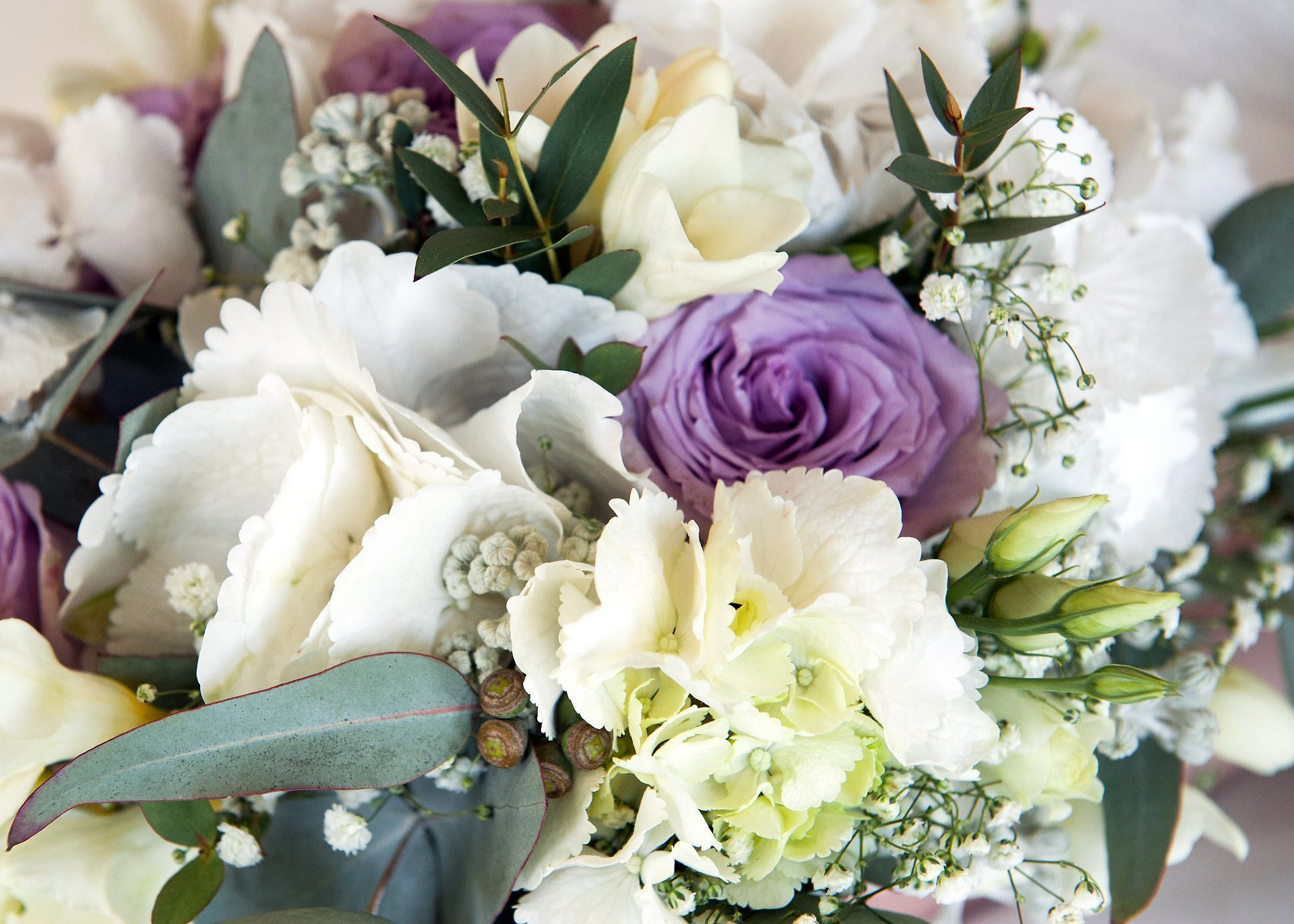 Jess's wedding bouquet in white, cream, mauve and green at Starborough Manor in Marsh Green, Kent