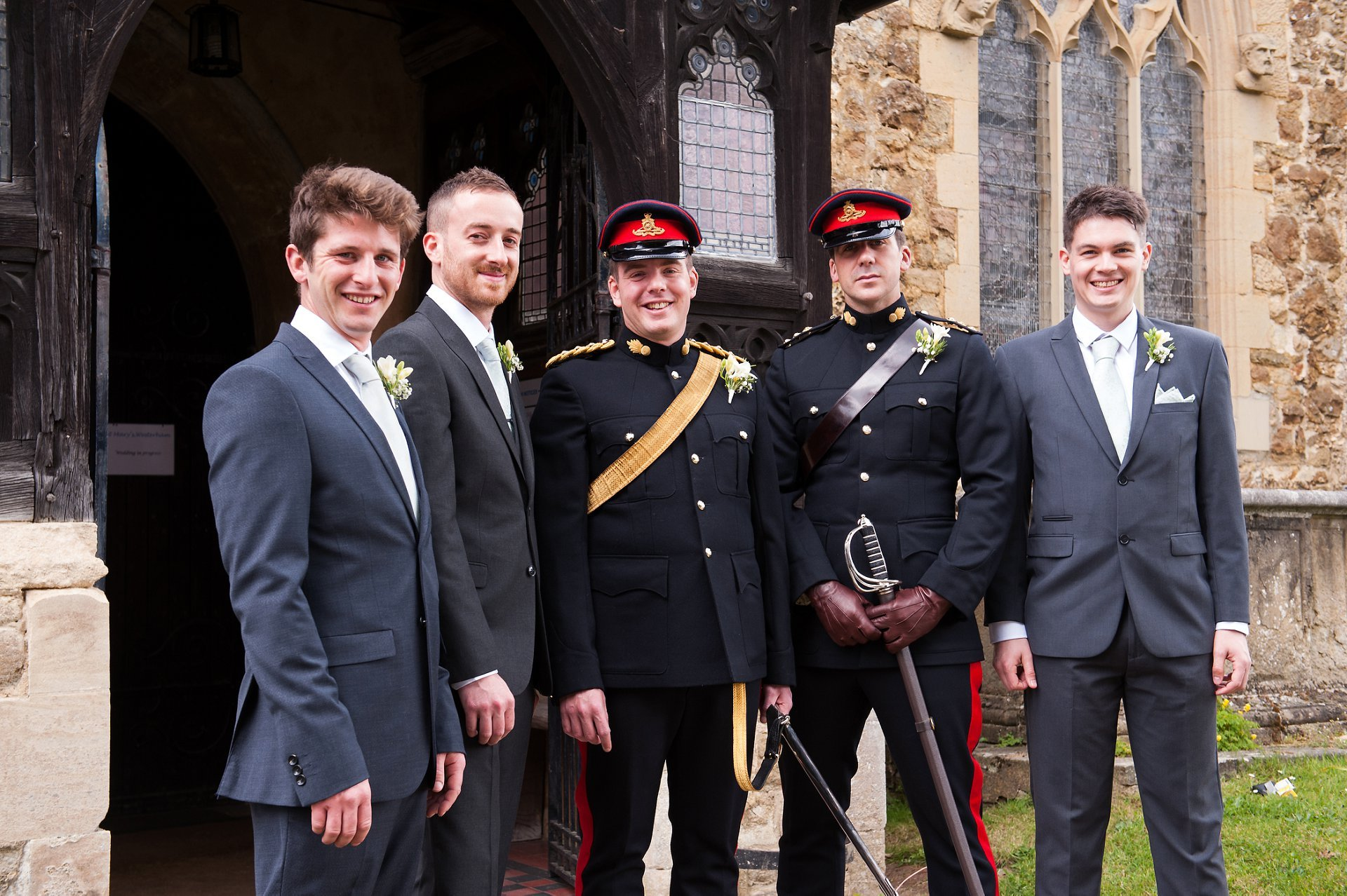 Groom, best man and ushers outside st mary the virgin, westerham, kent