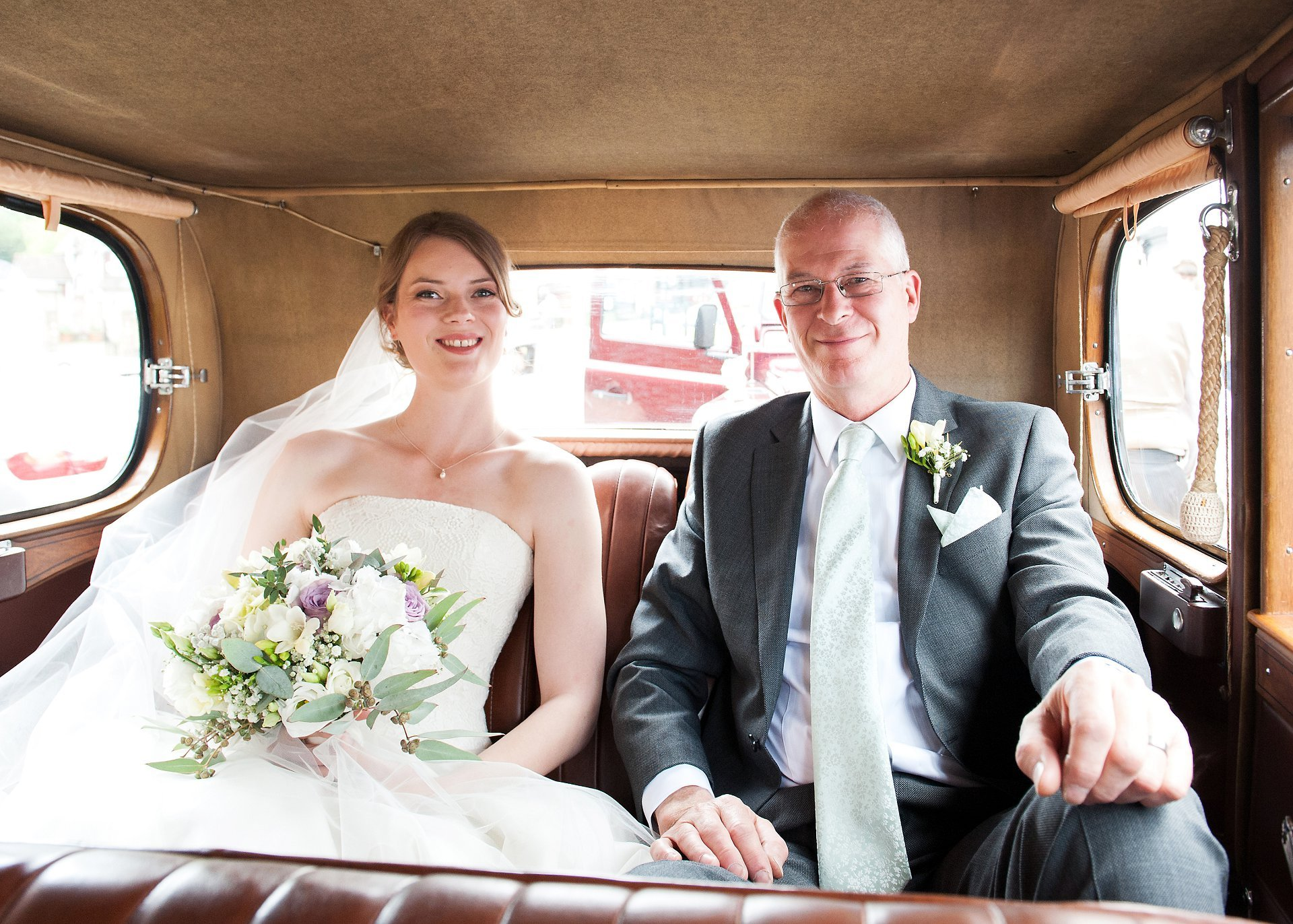 Bride, Jess, and her father, Trefor, arrive at St Mary the Virgin Church, Westerham in a vintage Wolseley County wedding car