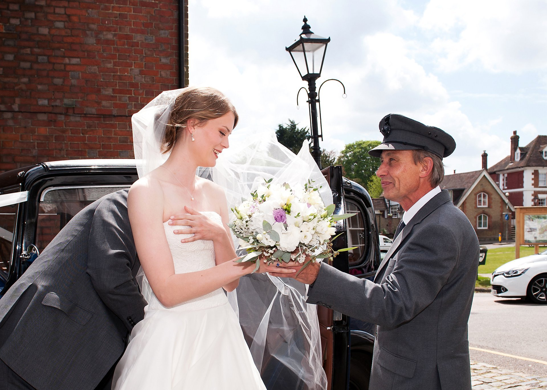 Jess receives her flowers from the driver of the Sovereign Chauffeur Services Wolseley