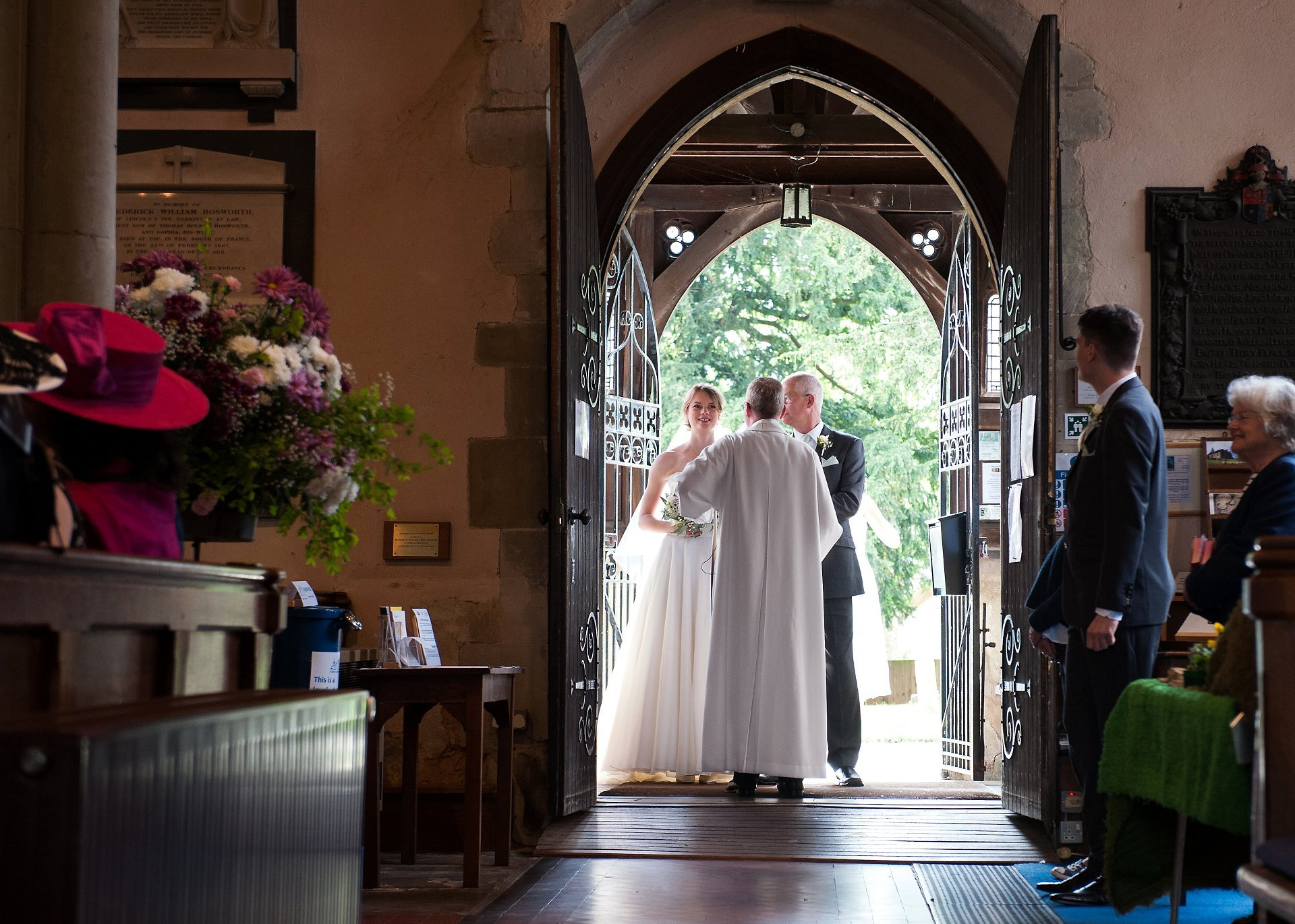Rev Kevin Barnard welcomes the bride and her father to St Mary teh Virgin in Westerham, Kent