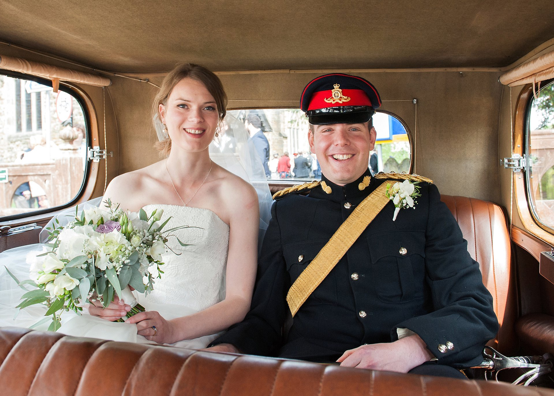 Starborough Manor Wedding Photographer - Bride and Groom inside the 1934 Wolseley County vintage car provided by Sovereign Chauffeur Services Crowborough
