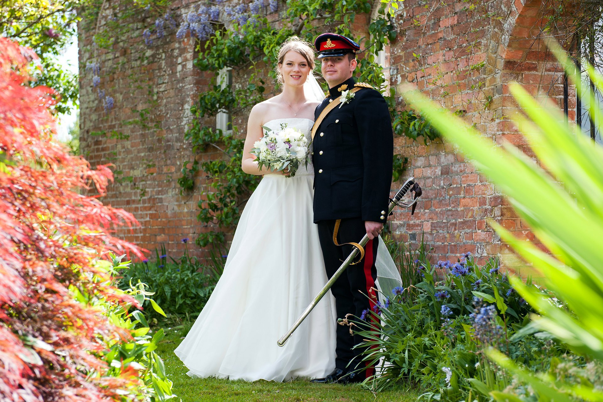 Bride and groom pose at Starborough Manor during their wedding reception