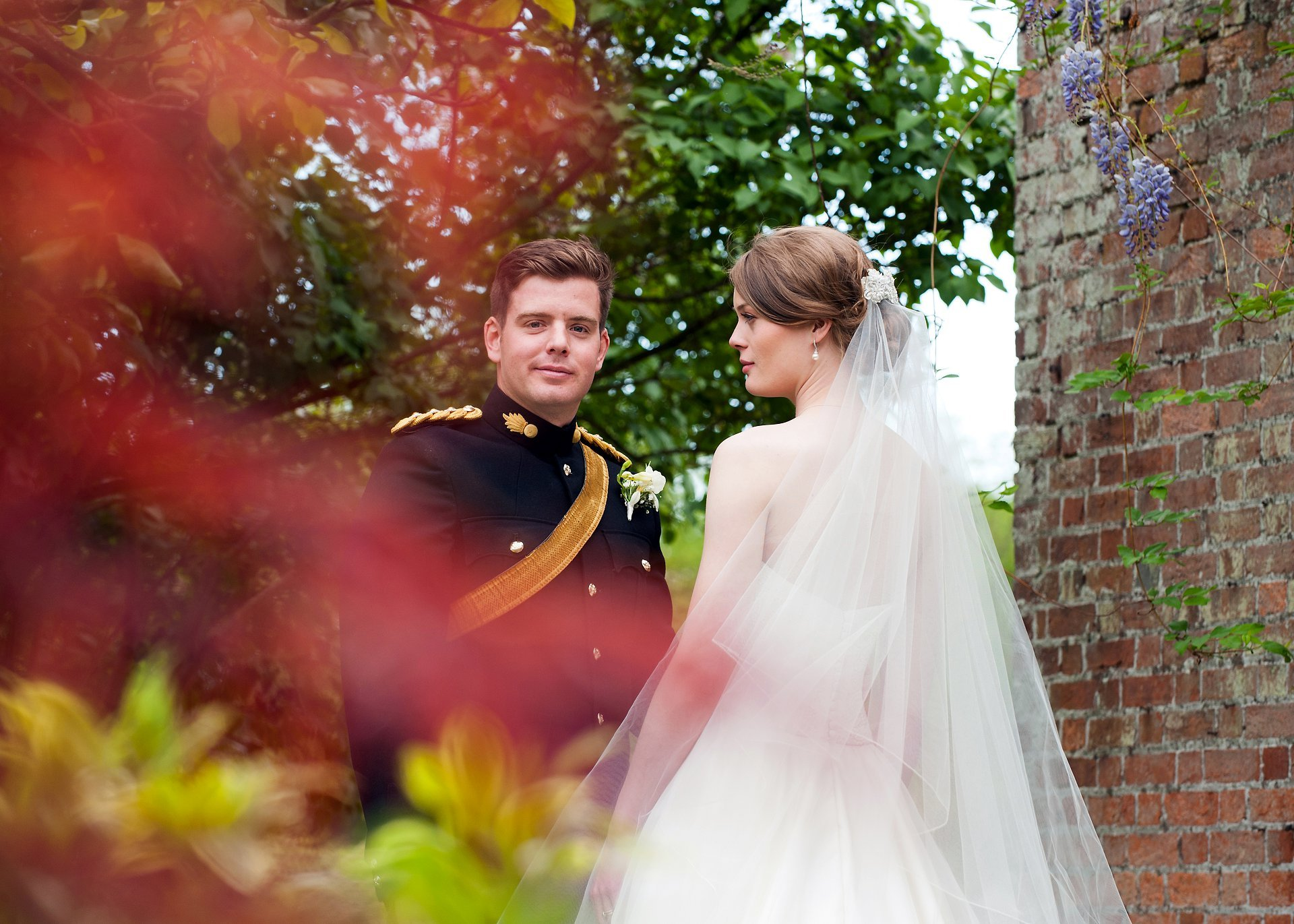 Bride looks on at her groom at Starborough Manor