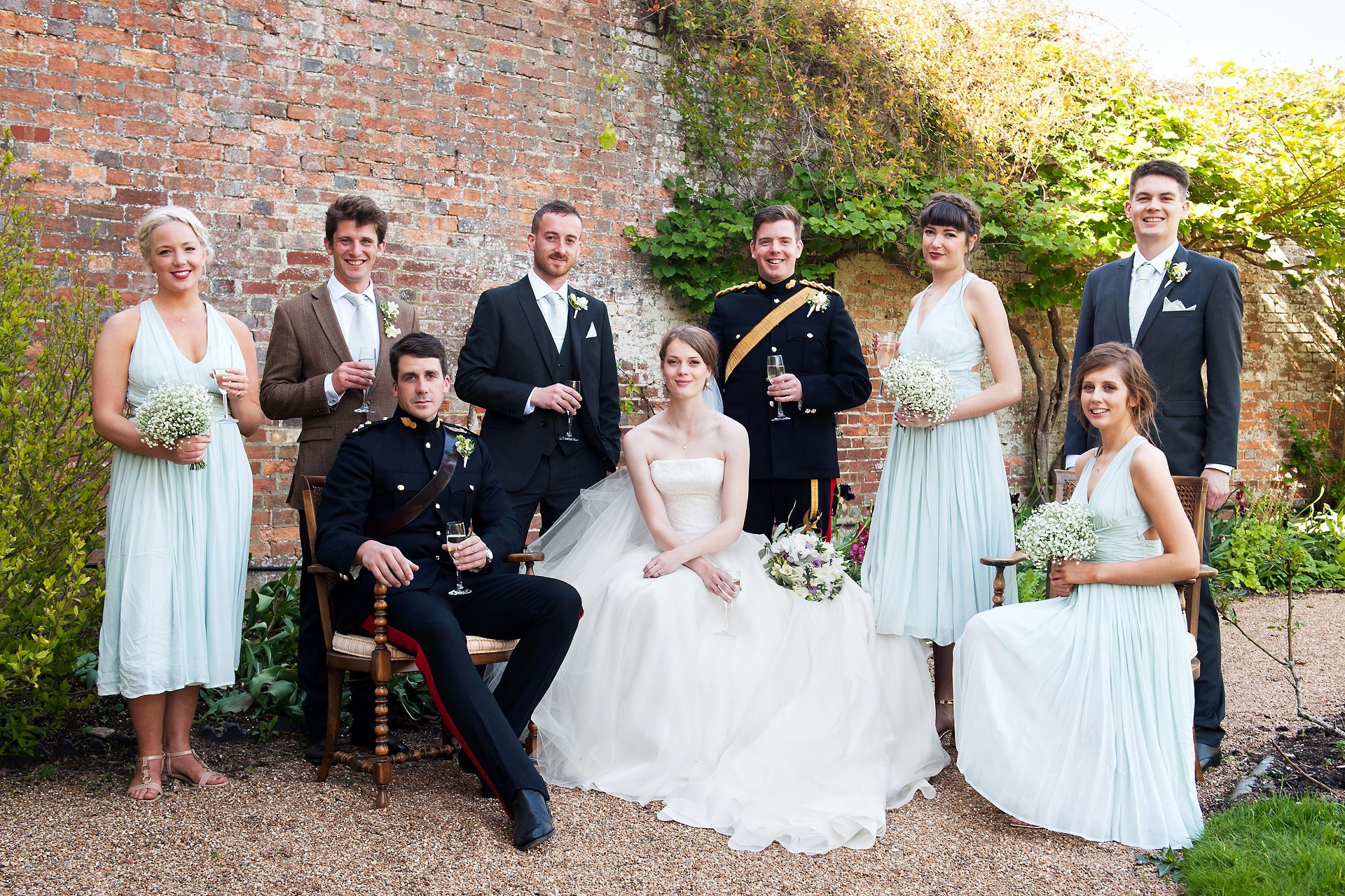 Bride and groom and their bridesmaids, best man, and ushers at Starborough Manor a Kent wedding venue set in beautiful ground just outside Edenbridge and Lingfield in Kent