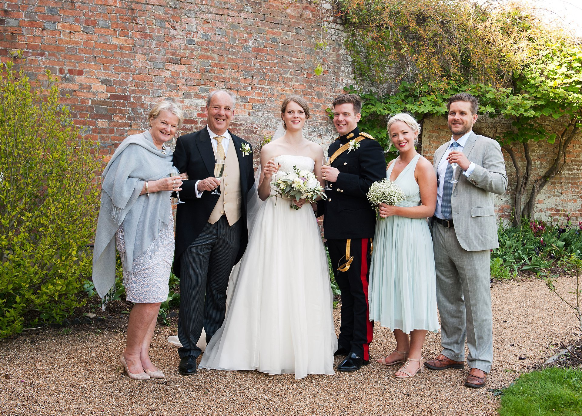 Groom's family in a family group photograph at Starborough Manor