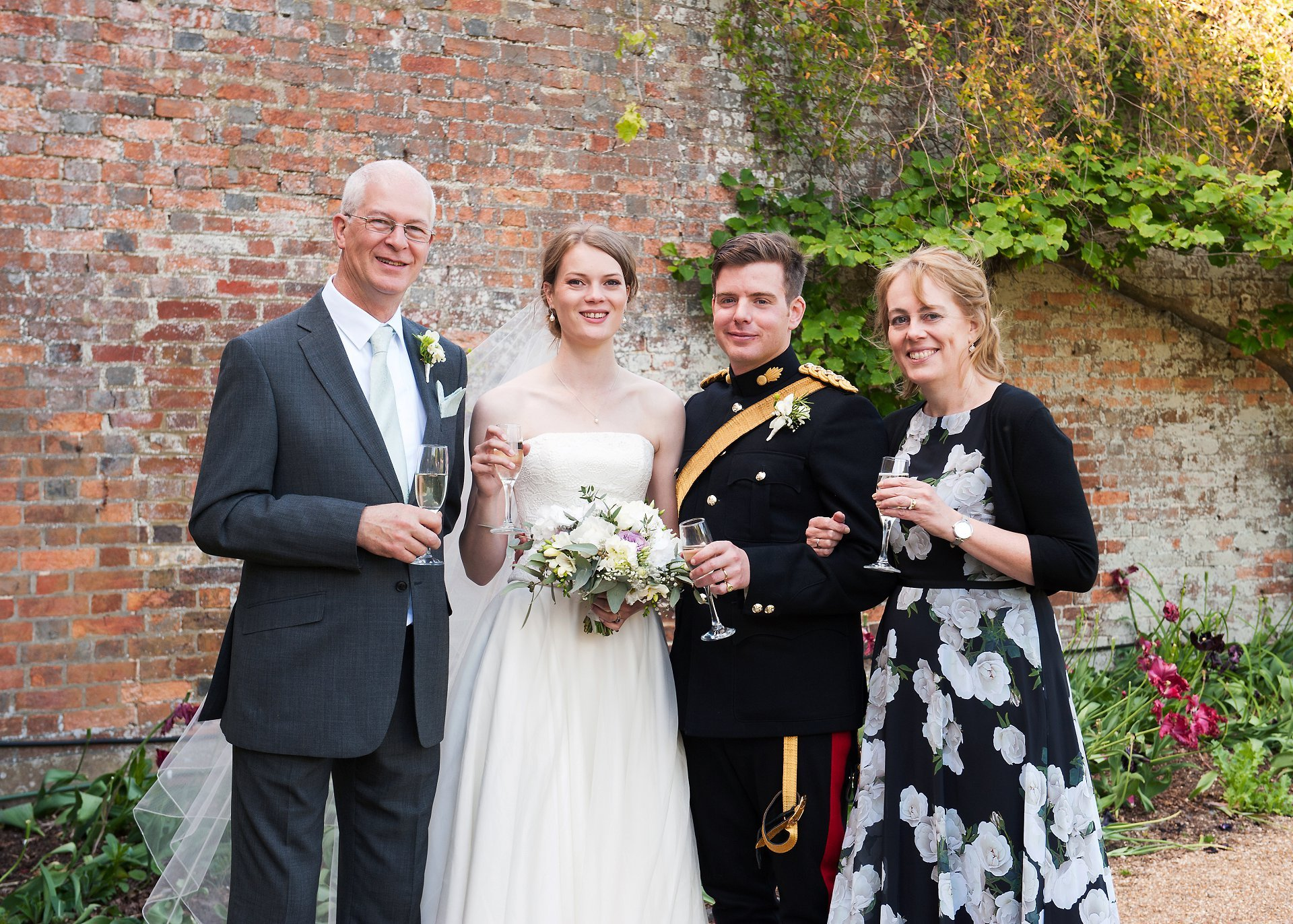 Brides family in a family group photograph at Starborough Manor