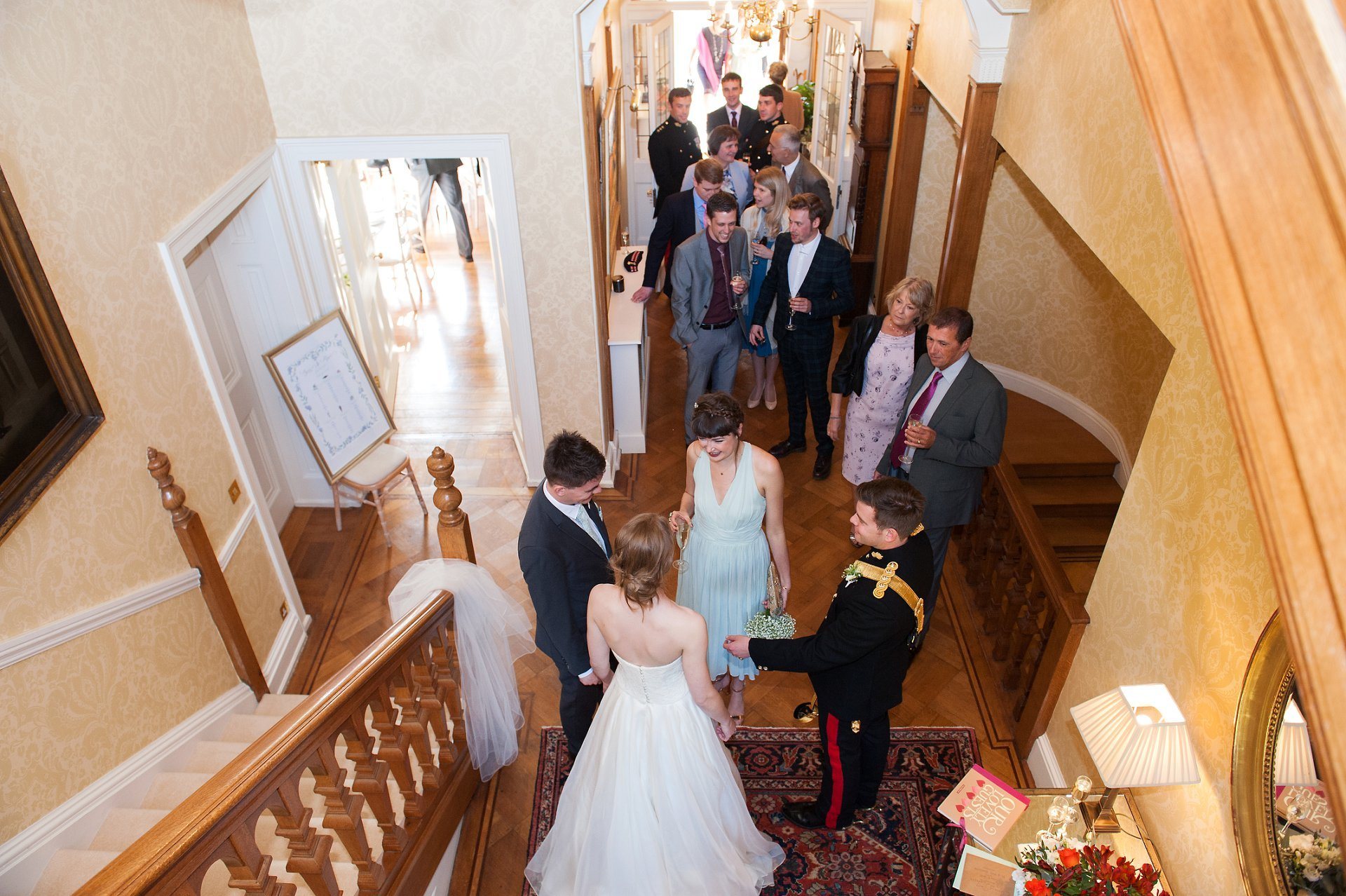 Receiving line in the hall inside Kent wedding venue, Starborough Manor