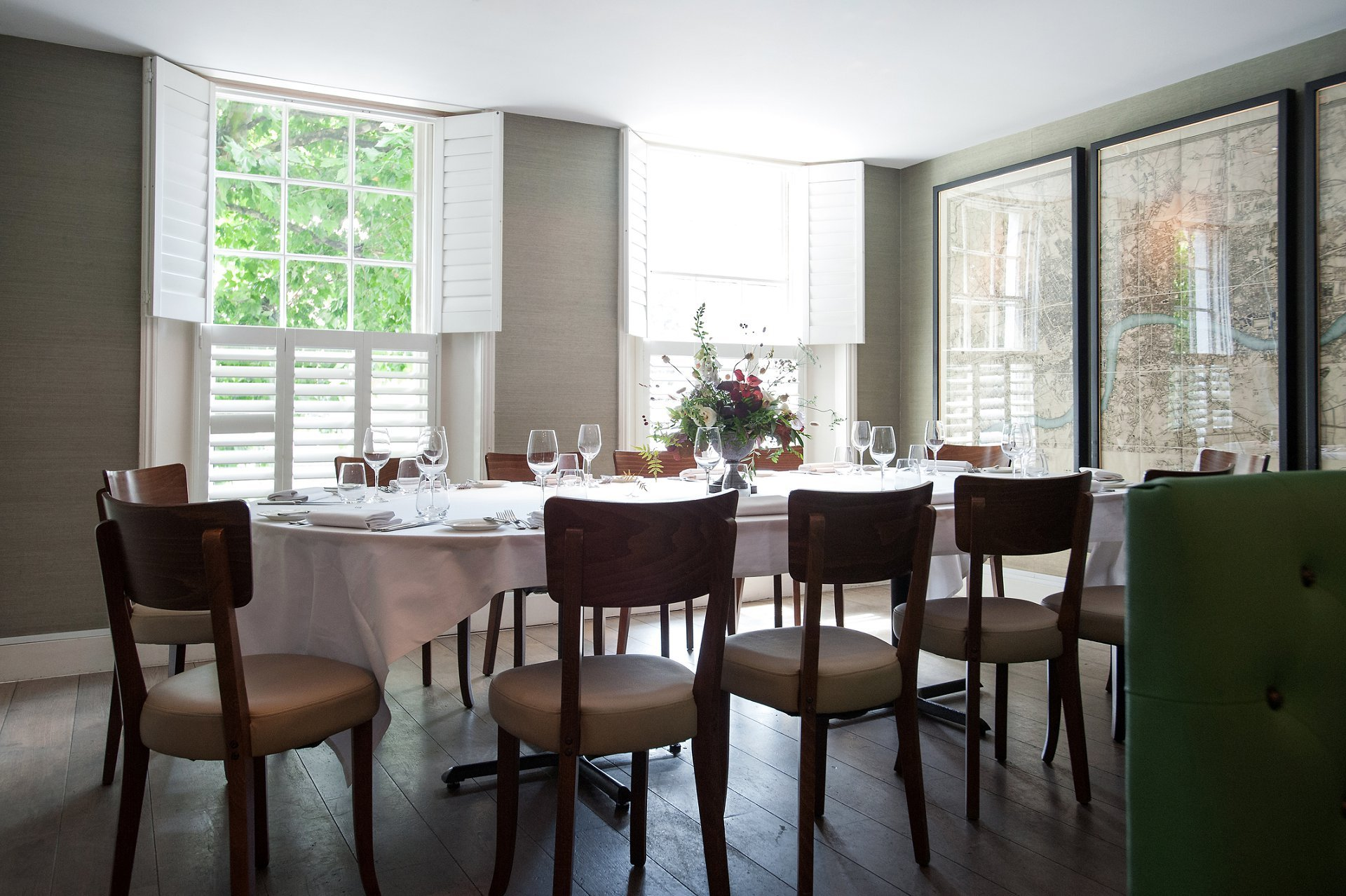 Chelsea Restaurant Medlar - the oval table in the private dining room of this King's Road restaurant laid for a small wedding reception lunch and a party of twelve guests
