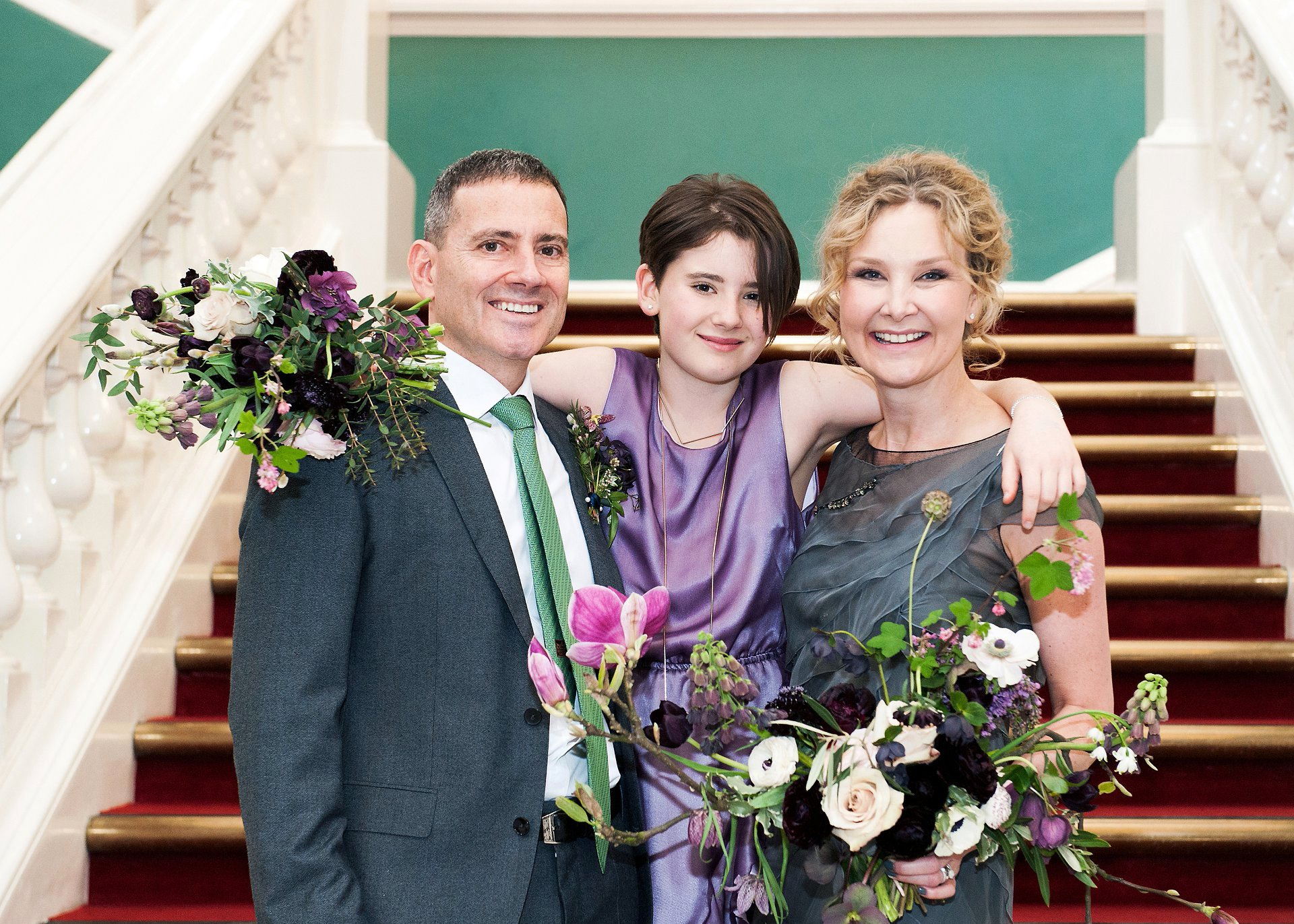 London florist Bloomologie created these bespoke wedding flowers - bridal and bridesmaid's bouquets and groom's buttonhole - for a small wedding in Greenwich Register Office (Woolwich Town Hall) photographed by Emma Duggan