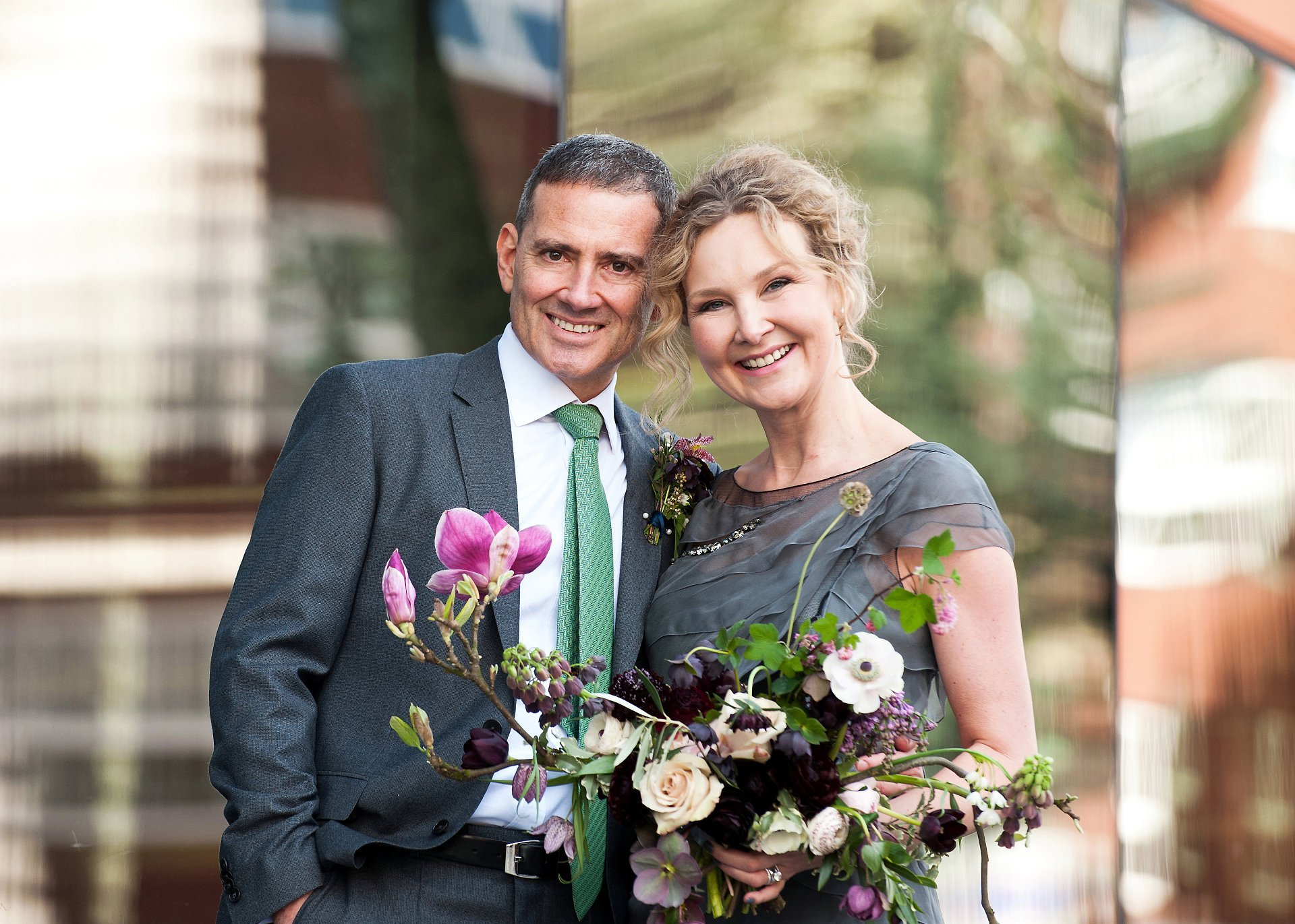 Bride and groom outside Greenwich Register Office (Woolwich Town Hall) after their register office wedding with flowers by Ali at Bloomologie in nearby Blackheath