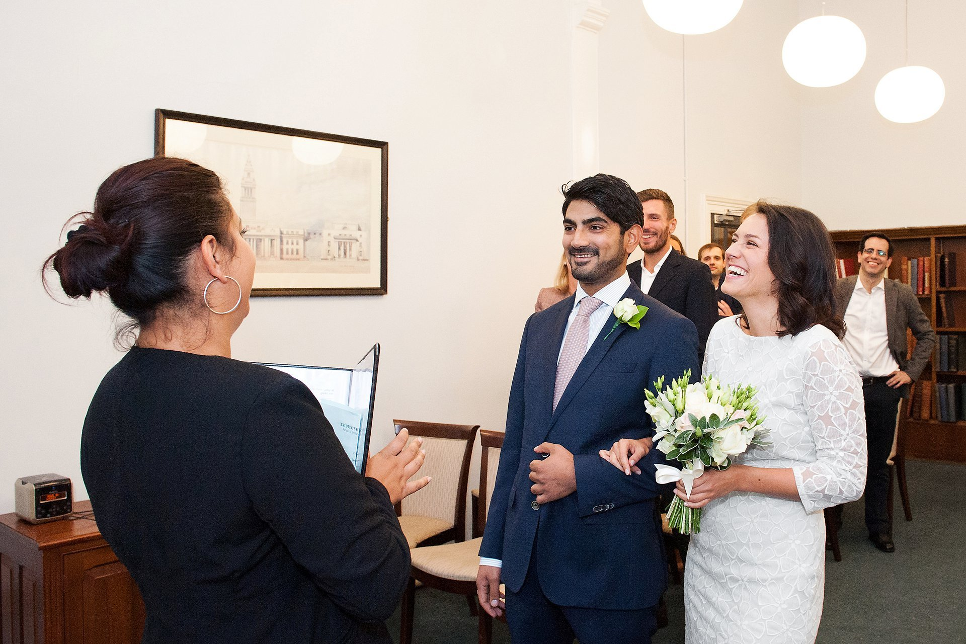 The Westminster Superintendent Registrar welcomes the bride and groom to their Mayfair Library wedding ceremony