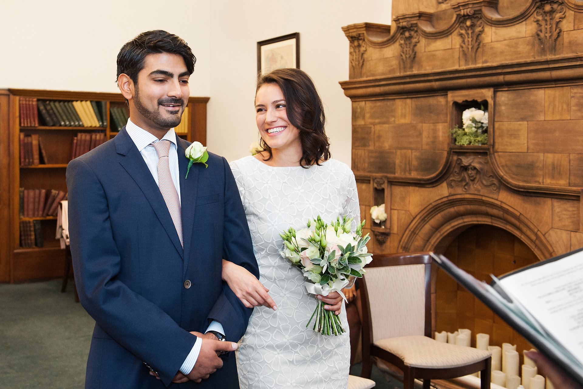 Westminster Register Office Mayfair Library - the bride and groom smiling at the start of their Marylebone Room civil marriage ceremony