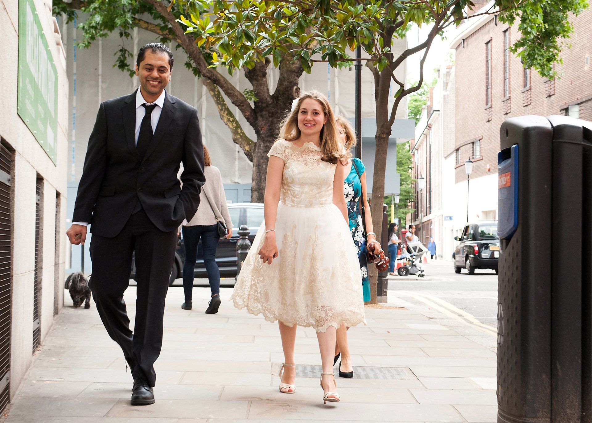 The bride and groom arriving at Chelsea Registry Office on the King's Road