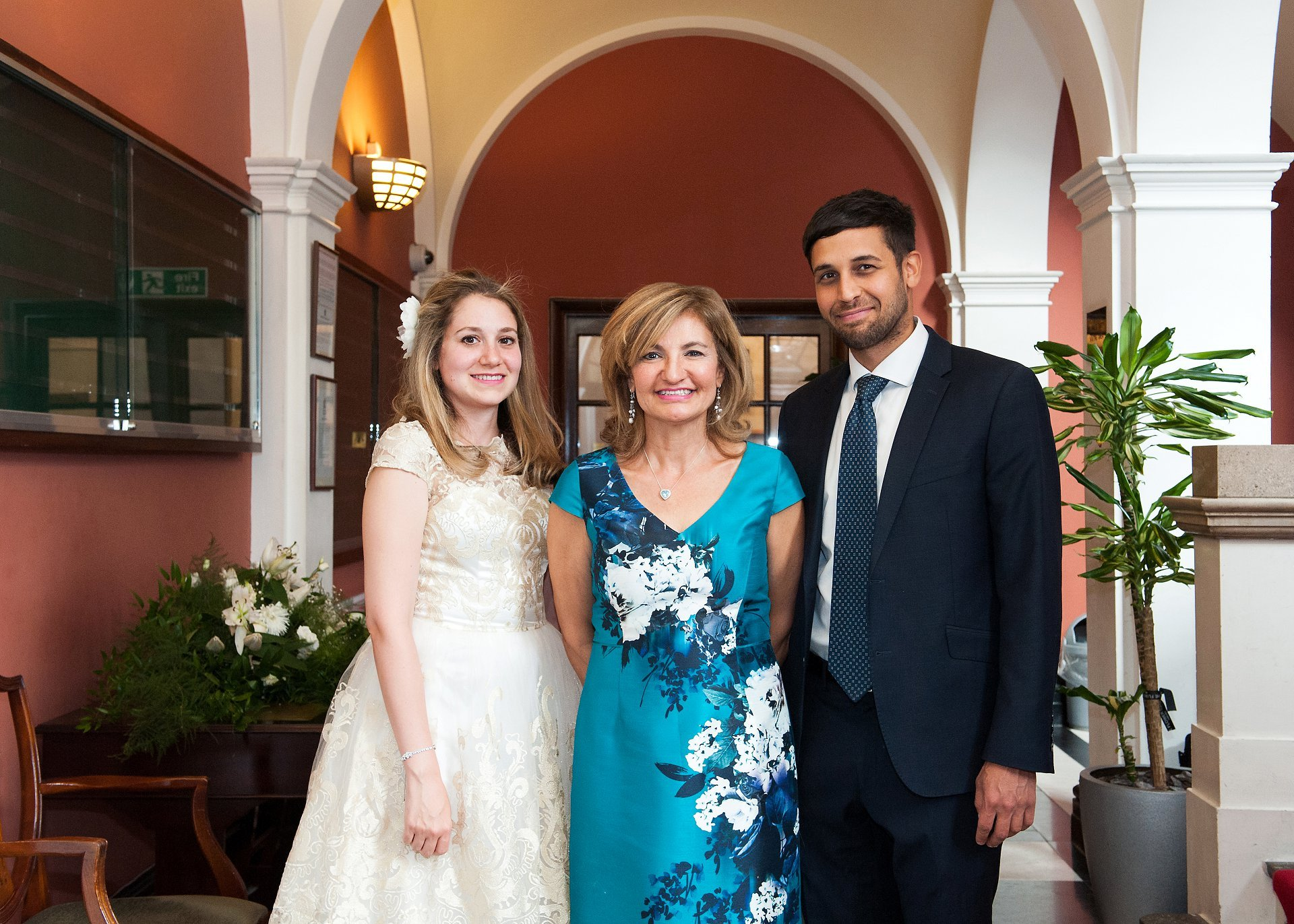 A bride and her bother and brother pose for a photograph by Emma Duggan Photography just before her civil marriage ceremony in Chelsea Old Town Hall