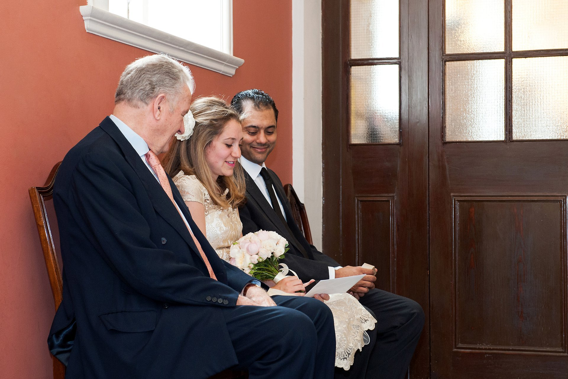The bride and groom in the waiting room at Chelsea Register Office