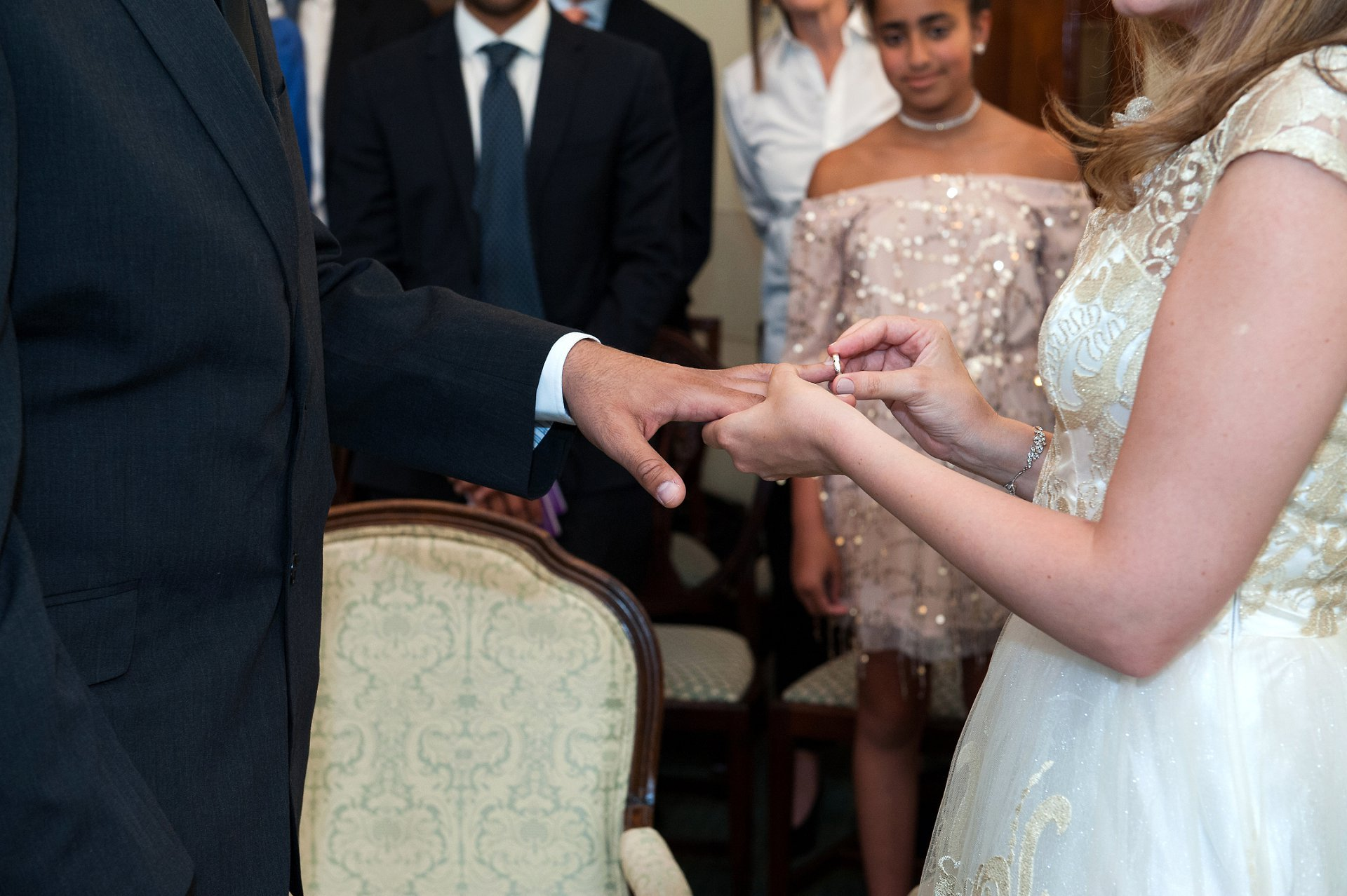 The bride exchanges rings with her husband-to-be in the Roseetti Room at Chelsea Registry Office
