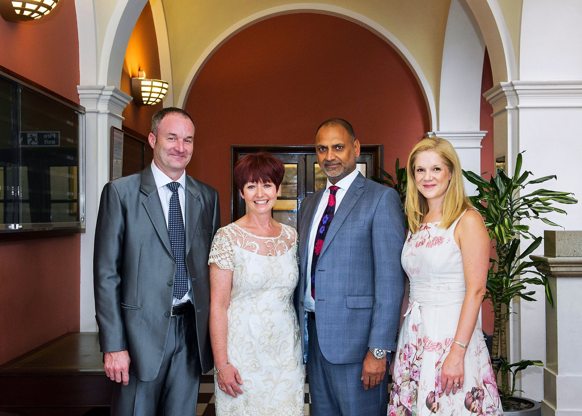 Bride and groom and their two guests and witnesses in the waiting area inside Chelsea Register Office