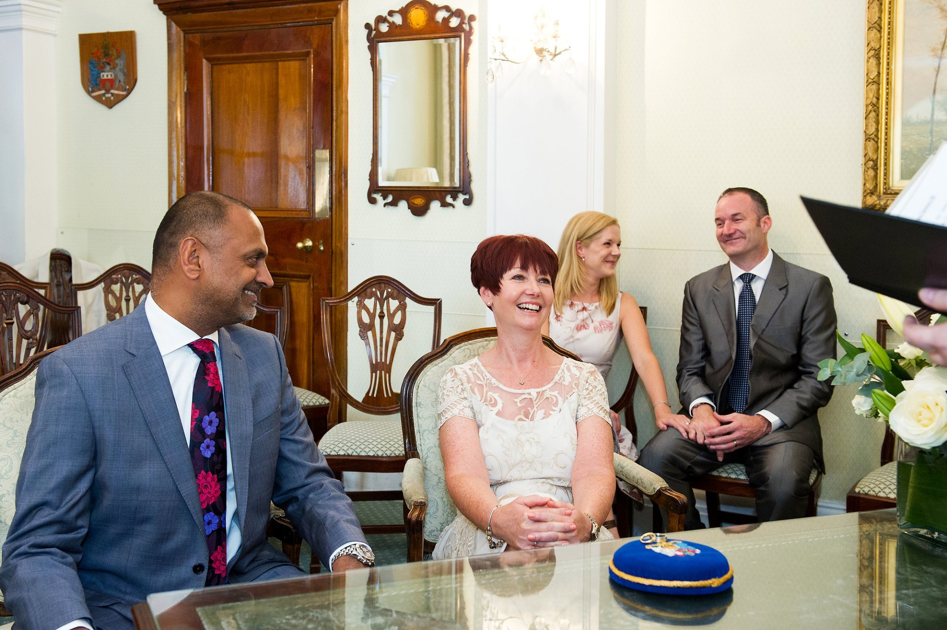 Rossetti Room Chelsea Registry Office is a charming and stylish civil wedding venue and seats up to 12 guests for your civil marriage ceremony. Here the couple and their two guests laugh during the short ceremony