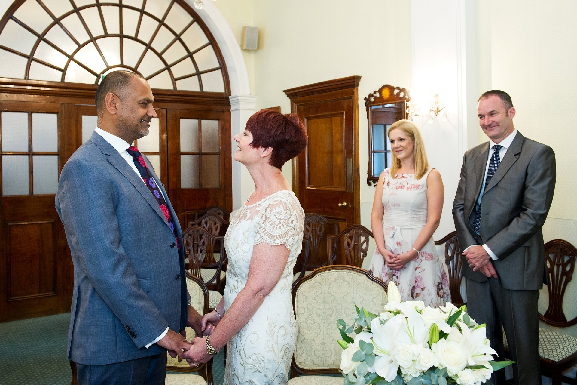 A Bride And Groom Exchanging Vows In Te Rossetti Room At Chelsea Registry Office