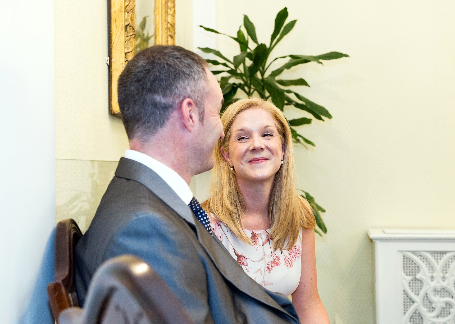 The two guests and witnesses smiling during this Chelsea wedding ceremony